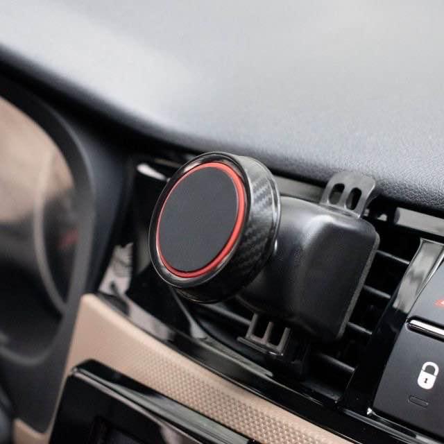 廠家直銷跨境汽車出風口360度旋轉磁性手機支架曬紋磁鐵手機座